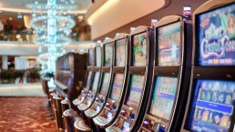 Row of gaming machines in a light room