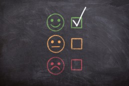 Compliance Reporting check with smiley face